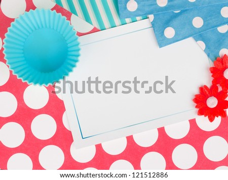 dotted card design with empty cupcake cup - stock photo