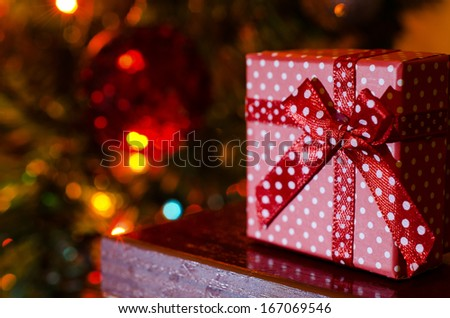 Dotted Christmas gift box on blurred background - stock photo