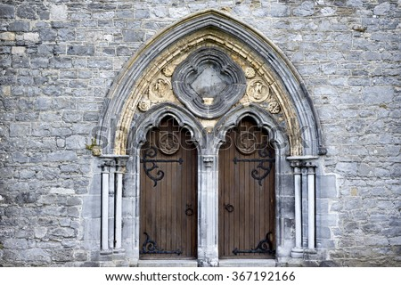 double arched wooden doors in to  St Caniceâ??s Cathedral kilkenny ireland - stock photo