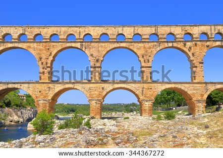 Double arches of the Roman aqueduct of Pont du Gard, Nimes, France - stock photo