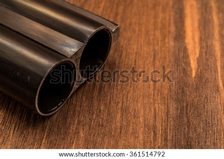 Double-barreled shotgun barrel. Close up view - stock photo