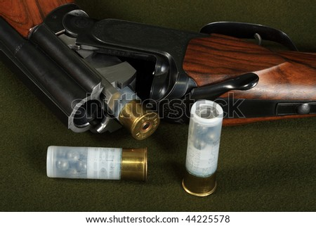 Double-barreled shotgun in discharged, and safe - stock photo