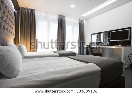Double bed hotel room interior - stock photo