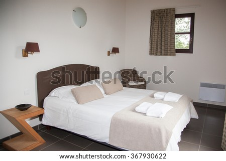 Double Bed In The Bedroom With Desk Lamp Near It