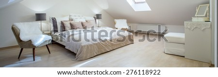 Double bed with a lot of cushions in luxury bedroom - stock photo