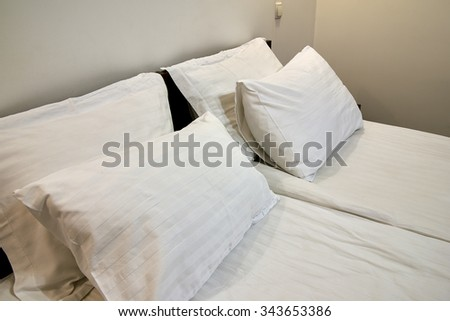 Double bed with pillows in bedroom