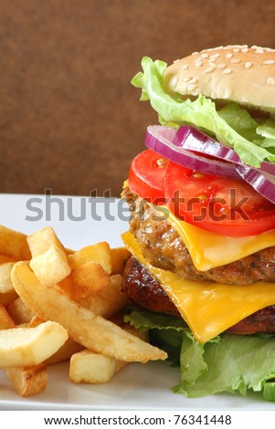 Double cheeseburger with fries - stock photo