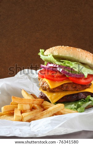 Double cheeseburgr with fries - stock photo