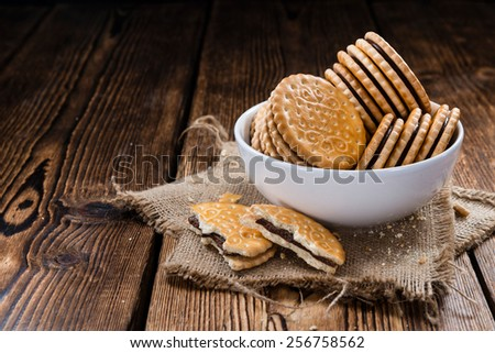 Double Cookies (with Chocolate Cream) on wooden background