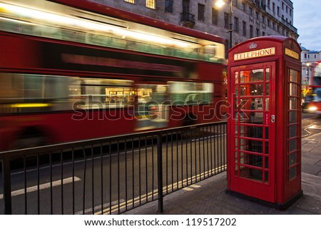 Double decker bus and red telephone box in London at night - stock photo