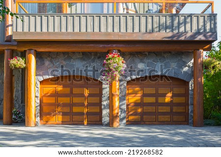 Double door garage in a modern log house in Canada - stock photo