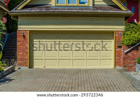 Double doors garage and nicely paved driveway. North America.