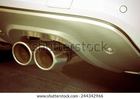 Double exhaust pipes of a sports car - stock photo