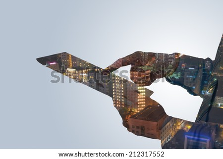 Double expose of human hands with digital tablet and night city: person in urban environment concept - stock photo