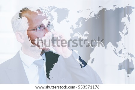 Double exposure, business man on phone with world map, global business concept