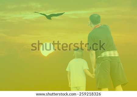 Double Exposure Effect green screen of sunset father and son point look at eagle bird fly on sky