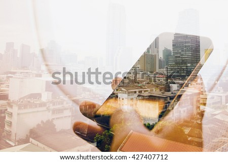 Double exposure image of businessman sitting in the airplane and using smart phone with cityscape background, Business technology concept. - stock photo