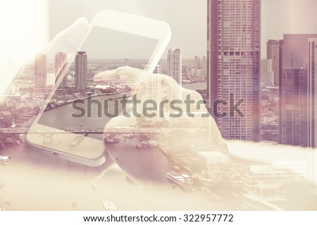 Double exposure image of people with smart phone and cityscape background - stock photo