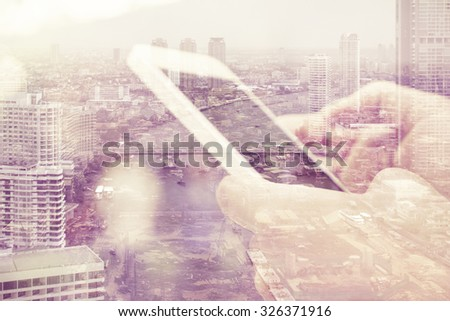 Double exposure image of people with smart phone and cityscape background,Business technology concept.  - stock photo