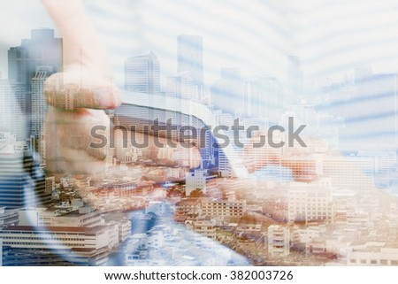 Double exposure image of people with smart phone and cityscape background,communication technology concept.  - stock photo