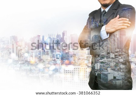Double exposure of a businessman and a city.