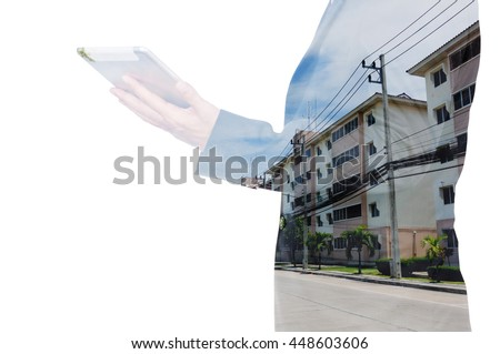Double exposure of a businessman and a city using a tablet over white background - stock photo