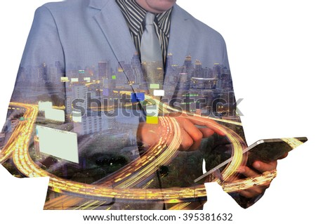 Double exposure of a businessman and a city using a tablet with City Scene and Expressway - stock photo