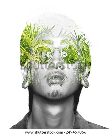 Double exposure of asian guy with glasses and nature