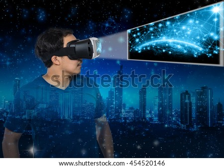 Double exposure of Asian man wearing virtual reality showing the earth planet with network line over star with the earth and cityscape background,Elements of this image furnished by NASA, VR concept - stock photo