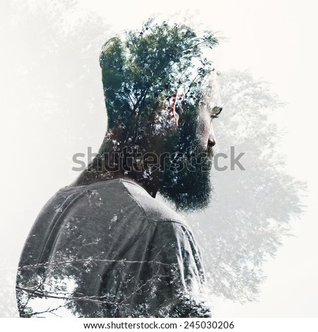 Double exposure of bearded guy and forest - stock photo