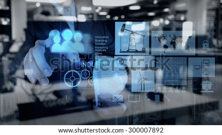 Double exposure of business engineer draw icon of industry and abstract city as concept