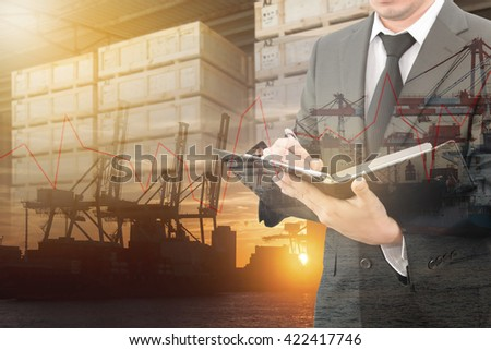 Double exposure of business man analyzing report with blurred port cargo and transportation port background, business trading export abroad concept - stock photo