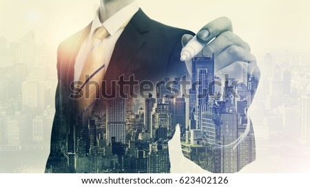 Double exposure of business man and big city