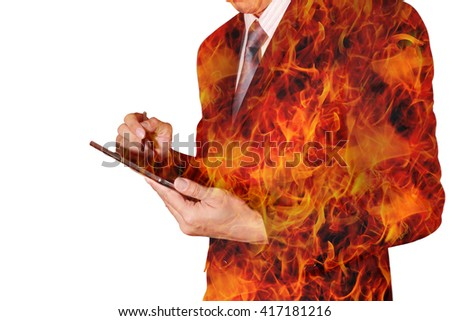 Double exposure of business man hand hold tablet and blaze fire background as hot, speed and technology concept.