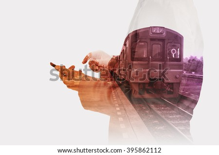 Double exposure of Business Man use Mobiel Phone with Train Station for use as Background in Modern Transportation concept - stock photo