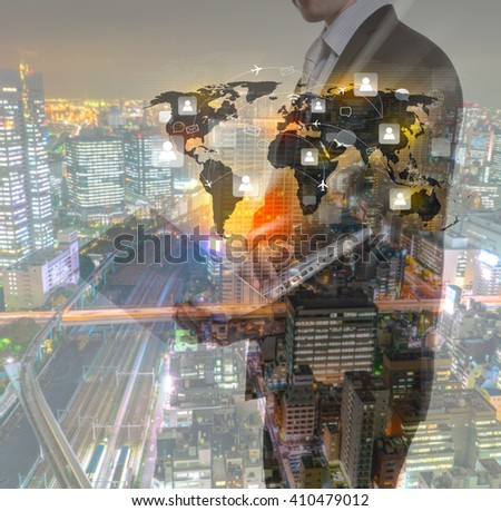 Double exposure of Business man with laptop and cityscape - stock photo