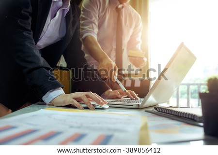 double exposure of business woman hand working on laptop computer on office desk with social media network diagram in morning light.vintage effect - stock photo