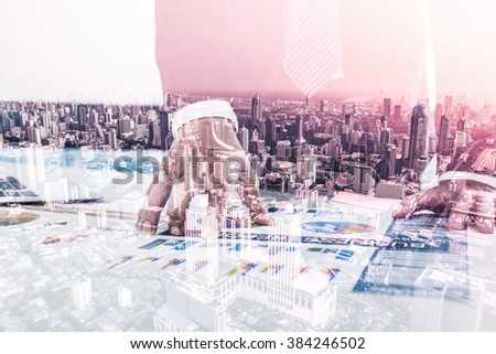 Double exposure of Businessman analyzing investment charts with laptop and city - stock photo