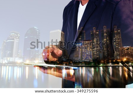 Double Exposure of BusinessMan and City with Business Meeting as Teamwork or Partnership Concept. - stock photo