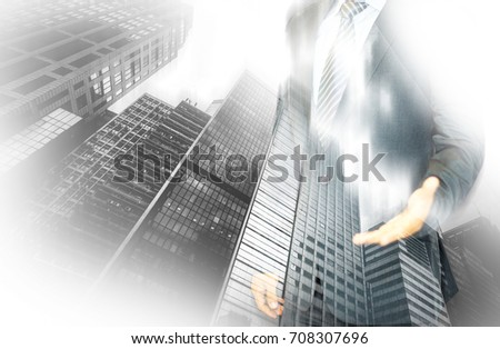 Double exposure of businessman and Hong Kong city view
