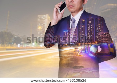 Double exposure of businessman calling with smartphone, urban, city and street at night as business, technology and telecommunication concept. - stock photo