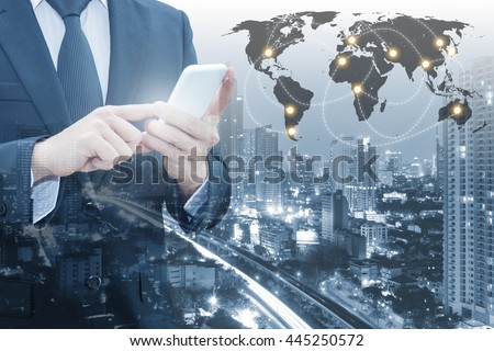 Double exposure of businessman connect internet smart phone & cityscape of business with world financial graph, Business, finance, trading and banking concept, element of this image furnished by NASA - stock photo
