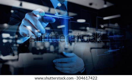 double exposure of businessman hand pushing on a touch screen interface - stock photo
