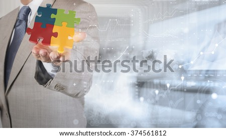 double exposure of businessman Hand showing 3d puzzle as concept  - stock photo