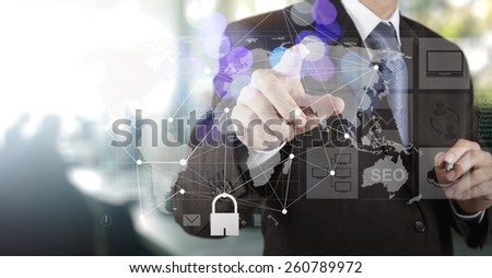 Double exposure of businessman hand shows modern technology as internet security concept - stock photo