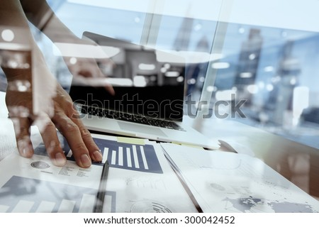Double exposure of businessman hand working with new modern computer and business strategy as concept - stock photo