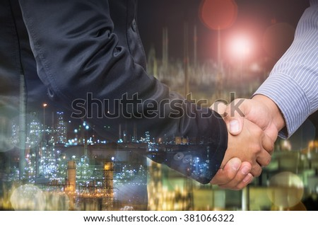 Double exposure of businessman handshake and industrial background. - stock photo