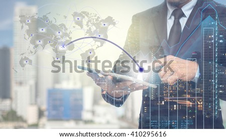 Double exposure of businessman using tablet for sending the email with cityscape and financial graph on blurred building background,Business Trading concept,Elements of this image furnished by NASA - stock photo