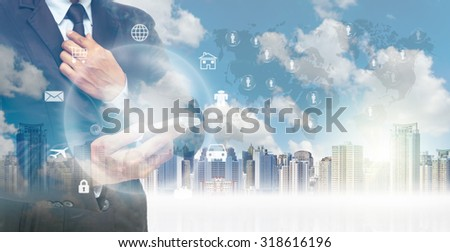 Double exposure of businessman using the tablet for Information technology on world map and cityscape background, business concept,Elements of this image furnished by NASA