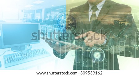Double exposure of businessman using the tablet with cityscape and financial graph which have earth and world map on computer blurred background, Elements of this image furnished by NASA - stock photo